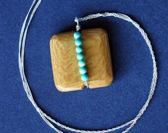 Collier avec pendentif en bois rayure turquoise