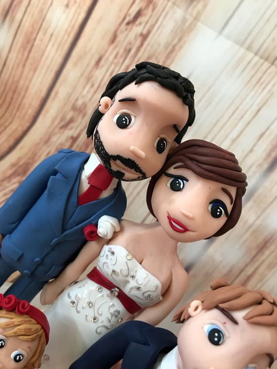 personalised clay Wedding Cake Topper highly detailed and fully sculpted christmas theme/red dress - bride and groom figures