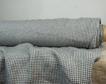 Pure 100% linen fabric 130gsm. Small 3mm graphite-anthracite gray and white gingham. Light weight, thin, washed-softened. For light clothes.