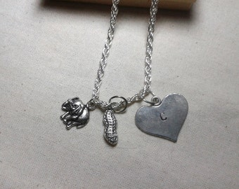 Elephant and peanut with handstamped initial on a heart shaped charm - long chain