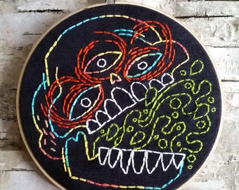 "green barf skull - 6"" hand embroidered wall hanging"