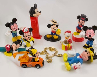 Disney Charm Bracelet Gold, Pluto, Donald Duck, Mickey Mouse Daisy,  10 Mickey Mouse toys and a Charm Bracelet  Pez Flashlight Rubber stamp