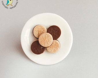 Hand made biscuits ring on ceramic saucer/ring with handmade biscuits on ceramic saucer