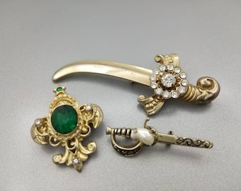 Coro Brooches Royal Regal Scimitar Sword Fleur de Lis Signed lot of 3