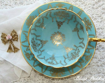 Coalport; turquoise tea cup and saucer with gold gilding