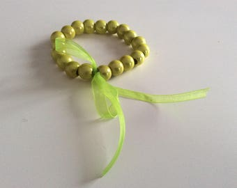 Lime green organza bow and lime green bracelet.