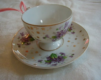 Beautiful Demitase cup and saucer with violets in wonderful condition.