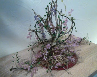 Floral purple Wisteria in seed beads, braided on driftwood. height 25cm x 35cm. Gift