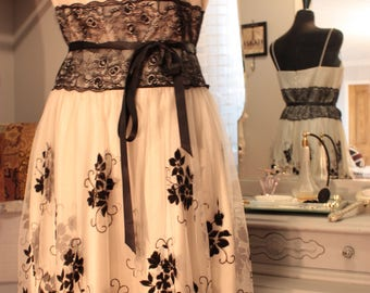 New Party dress in delicate white and black lace with flower detail