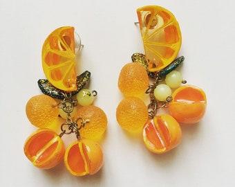1970s vintage lucite plastic orange dangle earrings