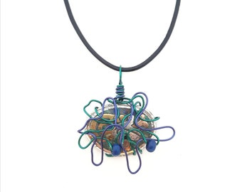 Blue and green necklace that can be worn as a pendant on a strip of leather or at the neck on a hoop