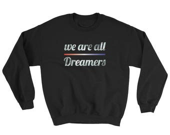 we are all dreamers crewneck sweater