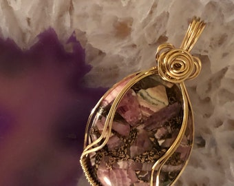 Copper Rhodochrosite Pendant wrapped with 14K Gold Filled Wire.   Copper Rhodochrsite properties are  Love, Balance, Compassion