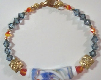 Bracelet: Blue/Orange/White Lampwork Tube, Fire Opal & Montana Blue AB Swarovski Crystal, Vermeil Squares, Gold-Filled Bicones, 14K GP Clasp