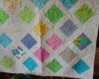 36 x 36 baby girl quilt.
