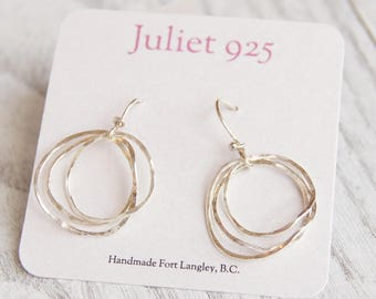 Hammered sterling silver hoop earrings on french hooks. Free shipping within North America