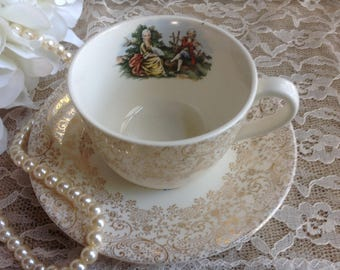 Royal China Co Colonial Gold Cup and Saucer Shabby Chic Wonderful gold filigree and Romantic Couple in Center 22-K-Gold