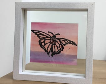 A Butterfly Lino Print in a white floating frame