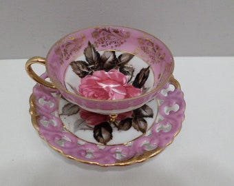 Royal Sealy China tea cup and saucer cup has three gold legs pink with pink rose