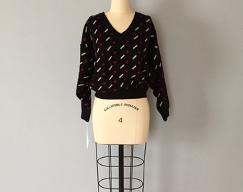 1980s black crop sweater | red dots and white bars print top | geometric print sweater