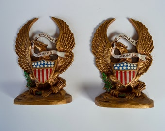 Pair Hubley Eagle Cast Iron Doorstopes