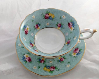 Paragon Tea Cup And Saucer Green Background with Floral Bouquets