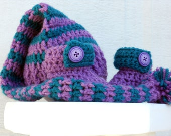 Crocheted baby pixie hat and booties set in plum and teal.