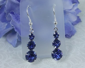 Stunning sapphire blue Swarovski crystal dangle earrings.Elegant for the evening sensational for the daytime.Matching necklace available too