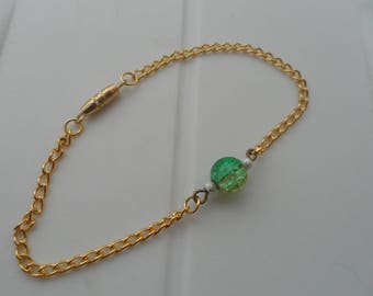 Gold chain bracelet and beads