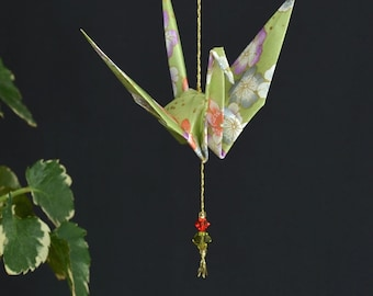 Origami Crane Hanging Ornament - light green Japanese paper with flowers, hand varnished, strung on gold string with Swarovski crystals
