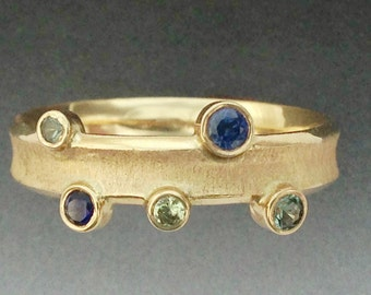 Solid 14K Gold Handmade Sapphire band with multi colored sapphires. A great Mothers Ring.