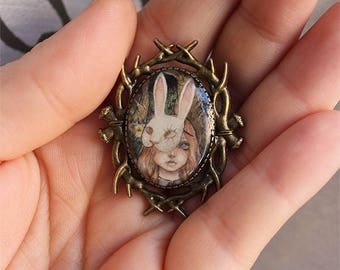 Brooch girl with a creepy bunny mask in the forest