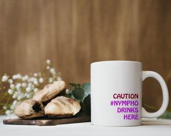 Caution #Nympho lives here Mug
