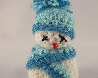 Christmas crochet amigurumi, snowman with light blue scarf and hat