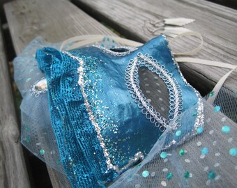 Teal and silver mask