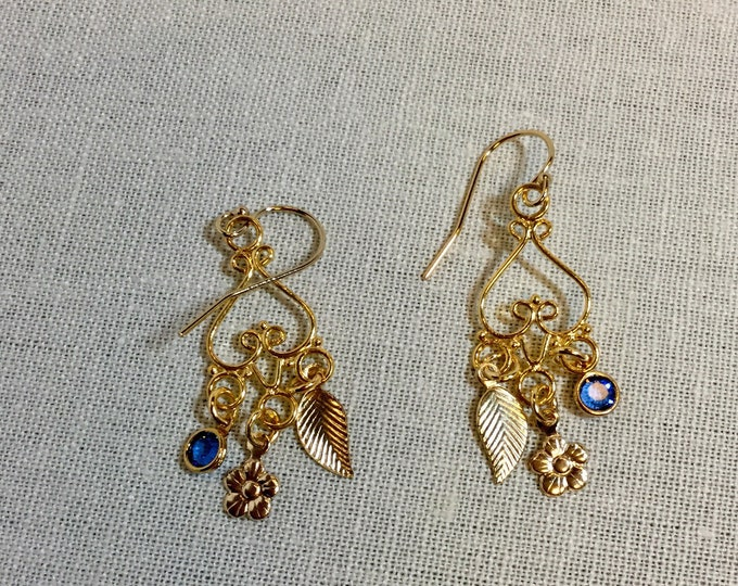 Gold chandelier earrings with leaf and blue drop charms