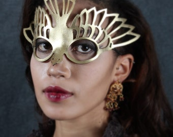 Bird mask in gold leather