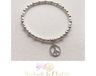Sterling Silver Stackable Stretch Oval Bead Bracelet with Peace Charm
