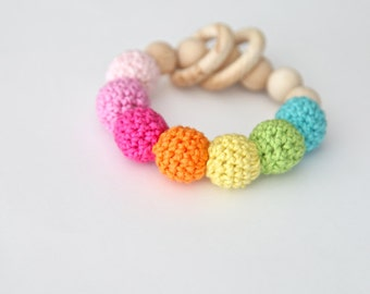 Multicolor nursing bracelet. Girlish rattle for baby. Teething ring toy with crochet wooden beads.