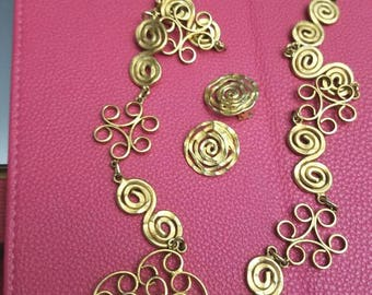 copper filigree and spiral design necklace with matching clip earrings