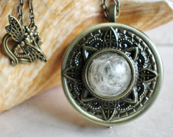 Music box locket etsy music box locket round locket with music box inside in bronze with dandelion wishes aloadofball Gallery