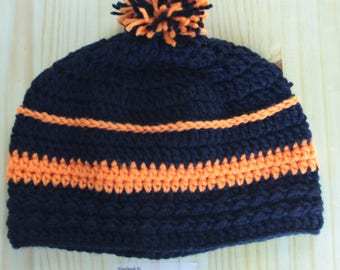 black and orange beanie with pom pom