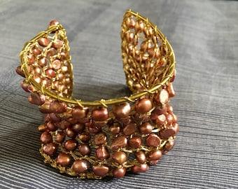 Beige pearl beads on brass wire cuff bracelet