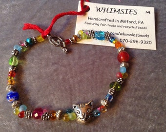Glass beaded bracelet, size MEDIUM. Cat face focal bead. Boho, hippie, fair trade, gift, free shipping. Made in USA.