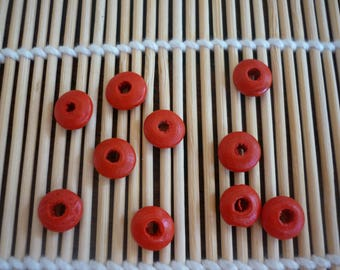 Red disc 10 mm wooden beads, sold in packs of 10.