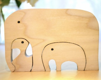 Wooden elephant toy and nesting puzzle
