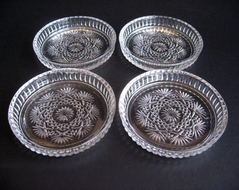 Set of Four Pressed Glass Coasters - Heavy Clear Glass With Starburst, Crisscross and Fan Design - Reeded Edge