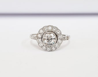 Art deco inspired diamond halo engagement ring in 18 carat white gold