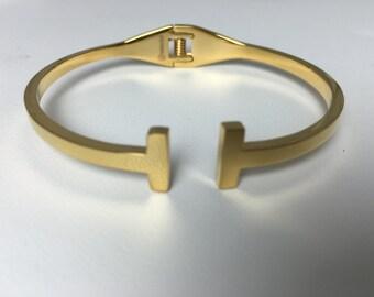 Gold t cuff bracelet