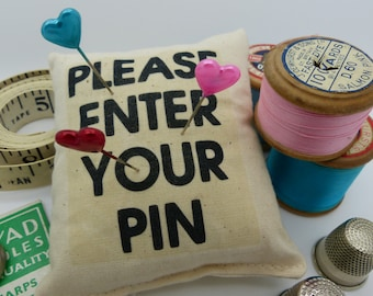 Pin cushion. Please enter your pin. Pins and needles.